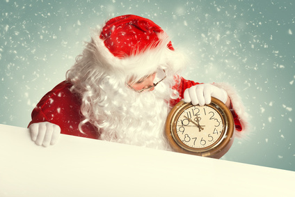 Santa Claus  with white blank banner holding a clock showing sev